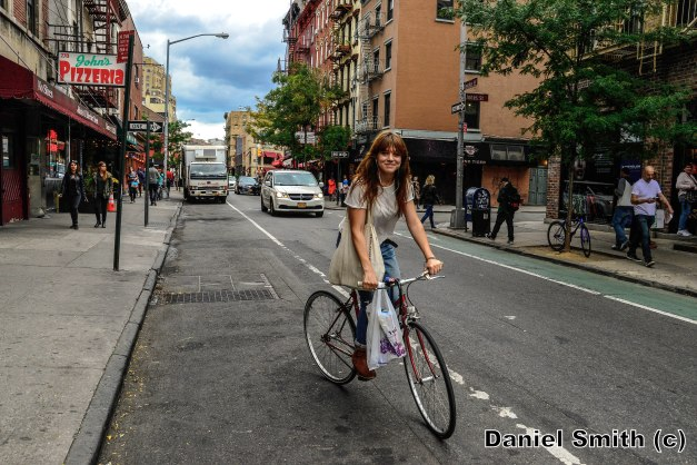 Girl Riding Bike At West Village